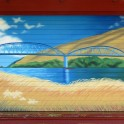 Millers Flat Bridge Scene - Acrylic on roller door. Shop at Millers Flat Holiday Park.